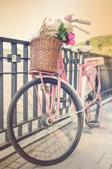 Vintage pink bicycle with flower basket