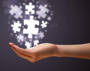 Puzzle pieces in the hand of a woman