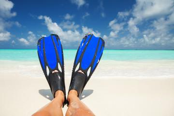 Snorkeler relaxing on the beach