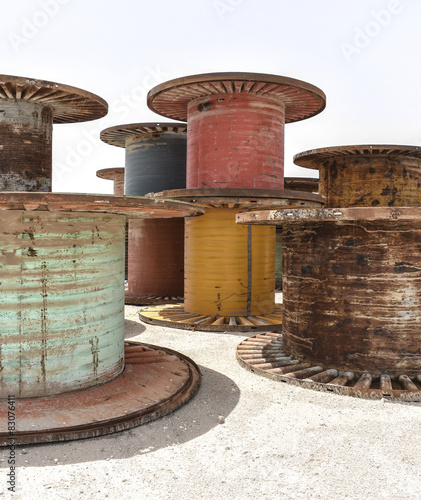 Large Corrugated Iron And Wooden Cable Spools In The Desert Stock