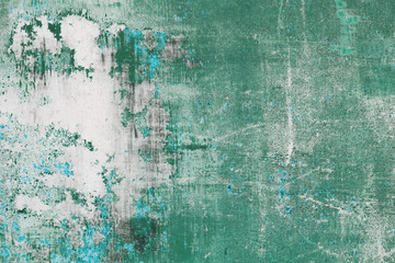 scratched green metal surface