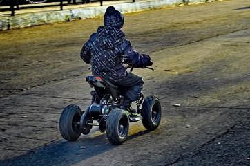 boy rides on electric ATV