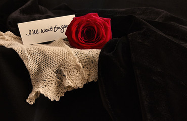 Red Rose with handwritten note