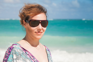 Young beautiful Caucasian woman in sunglasses