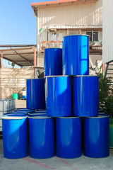 Blue barrels on a chemical plant