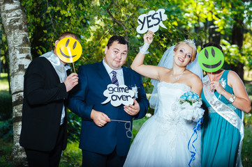 portrait of newlywed couple having fun with bridesmaids and