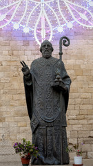 Bronze statue with luminaria of St. Nicholas. Bari,