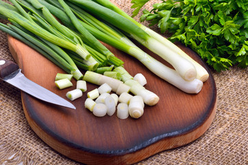 Chopped green onions with parsley  and knife