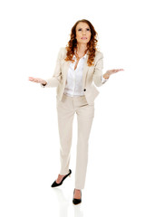 Businesswoman holding something on her hands.