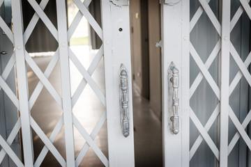white old steel door in home of thailand