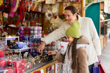 girl with mom buying decorations