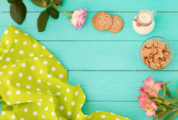 breakfast on blue wooden background,tablecloth ,flowers.