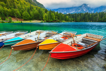 Stunning alpine landscape and colorful boats,Lake Fusine,Italy