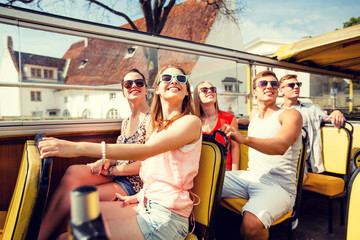 group of smiling friends traveling by tour bus Wall mural