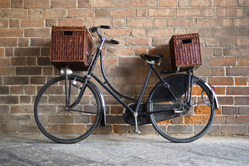 Old style bicycle with baskets