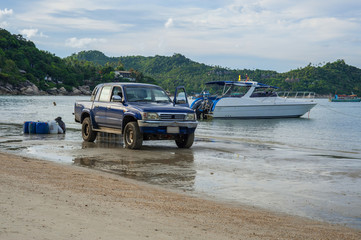4x4 and boat on a beach