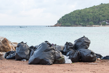 garbage(Black bag) on the beach