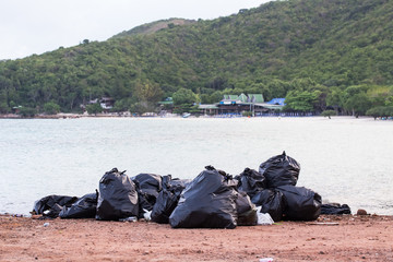 garbage(Black bag) on the beach