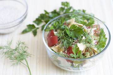Salad: tomatos, cucumber, dill, parsley, cheese, sesame
