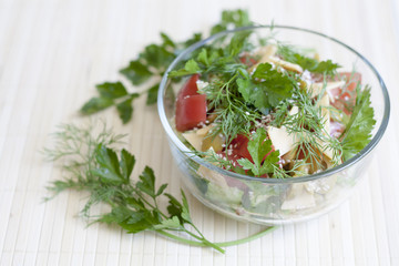 Salad: tomatos, cucumber, dill, parsley, cheese, sesame