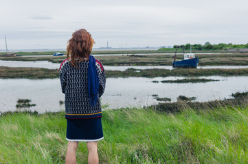Woman walking in marshes