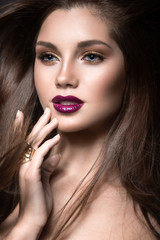 girl with golden makeup and burgundy lips