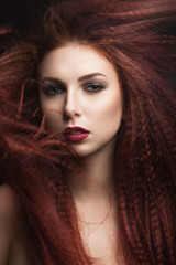 girl with bright makeup  with the wind in hair.