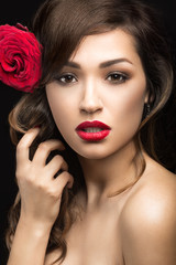 girl in the Spanish of Carmen with red lips and rose