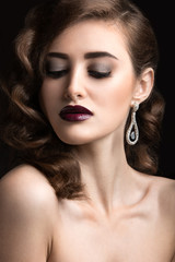 woman with evening make-up, burgundy lips and curls.