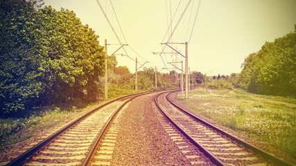 Retro filtered picture of railroad tracks.