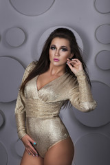 young beautiful girl in a gold dress