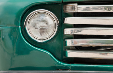 A single headlight from a classic car.