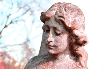 Close up of stone cherub in the cemetery