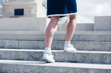 Woman walking up steps of memorial