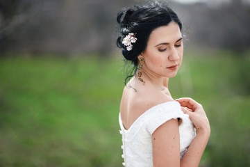 The thoughtful spring bride with flowers in hair