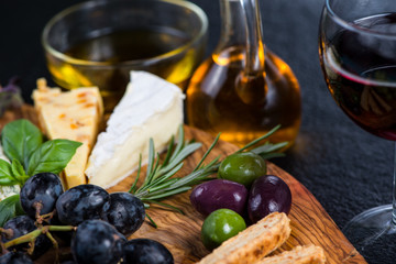 Tapas style board with cheese,olives and wine