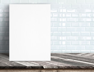Black White paper poster lean at white ceramic tile wall and tro