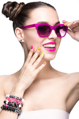 girl in sunglasses with bright makeup and colorful nails.