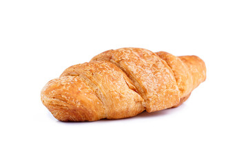 Tasty croissant on a white background.
