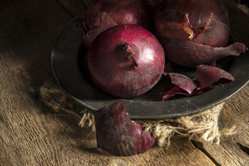 Moody natural light vintage retro style image of fresh red onion