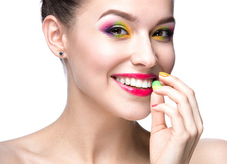 girl with colored makeup and nail polish in the summer image.