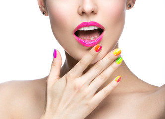 Beautiful girl with bright colored makeup and nail polish