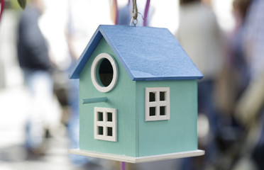 Blue bird house hanging on a tree