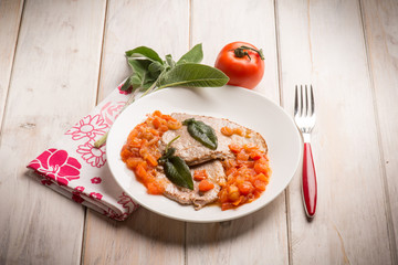 escalope with tomatoes and sage