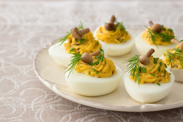 Stuffed eggs with mushrooms, green onions, dill and mayonnaise