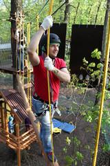 Man climbing at adventure park