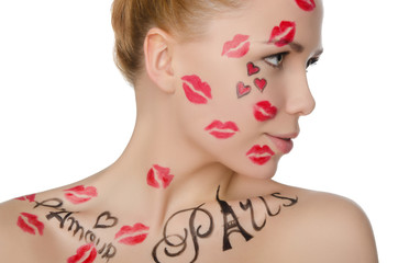 young woman with face art on theme of France