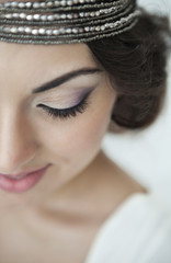 Portrait of the bride with big beautiful eyes on white backgroun