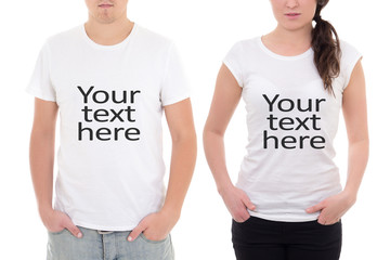 "man and woman showing t-shirts with ""your text here"" isolated on"