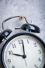 Unusual picture of vintage alarm clock hanging on the wall